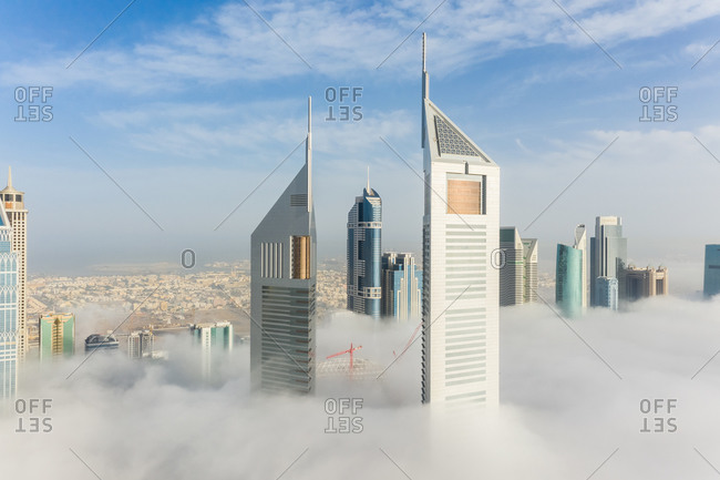 March 29, 2019: Aerial view of misty Emirates Office Tower skyscrapers in Dubai, United Arab Emirates.