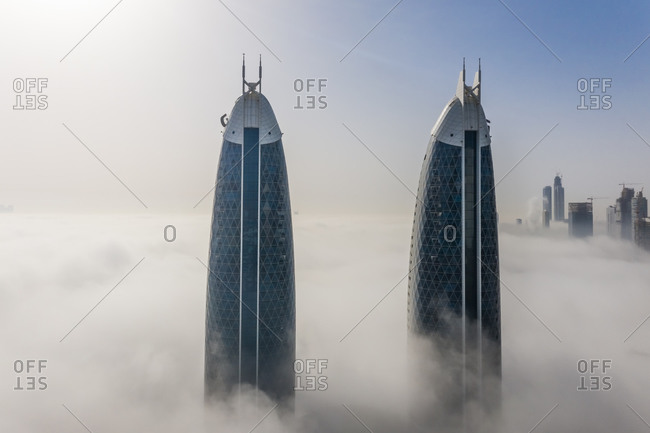 March 29, 2019: Aerial view of misty Twin Park Towers in Dubai, United Arab Emirates.