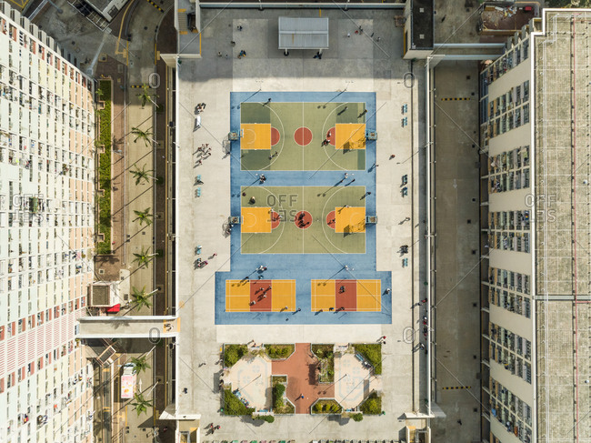 Aerial view of basketball courts in urban environment, Wong Tai Sin District, Hong Kong.