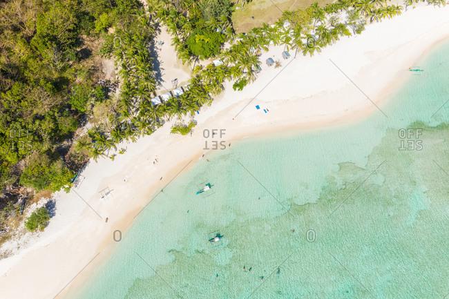 Aerial view of beach on tropical island of Malcapuya, Palawan, Philippines.
