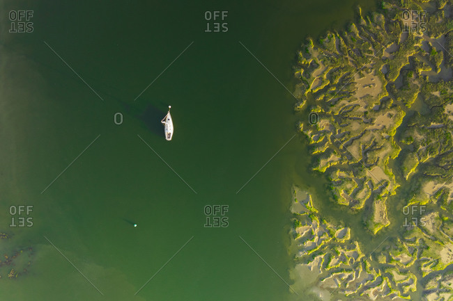 Aerial view of sailing boat moored on the River Beaulieu, near Southampton, UK.