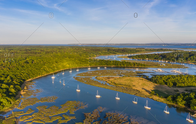 Aerial view of sailing boats moored on the River Beaulieu, near Southampton, UK.