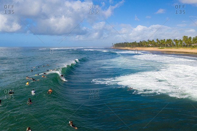 May 24, 2020: Aerial view of surfers in waves close to Praia do Forte and Praia do Lord, Brazil.