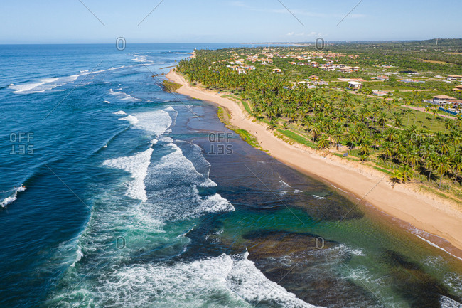 Aerial view of coast and waves close to Praia do Forte and Praia do Lord, Brazil.
