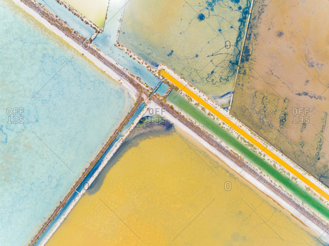 Aerial view of abstract colorful salt flats, Cagliari, Sardinia.