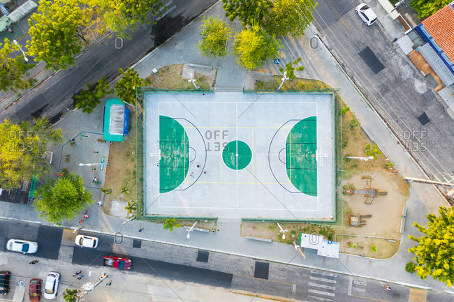 September 19, 2019: Aerial view of basketball and multi sport ground and street in a neighborhood close to Fortaleza in Brazil.