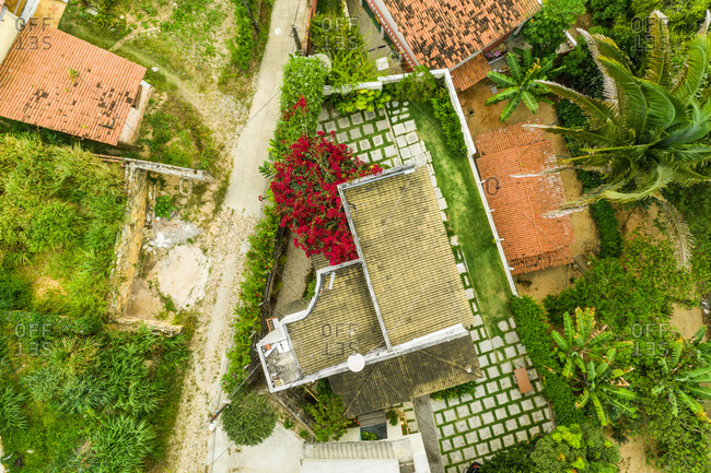 Aerial view of red rooftops and street in a neighborhood close to Baturita in Brazil.
