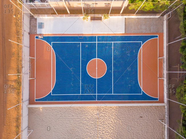 Aerial view of basketball and multi sport ground and street in a neighborhood close to Aquiraz in Brazil.