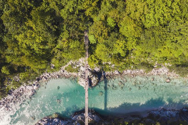 Aerial view of suspension bridge over Soca river at Kobarid- Slovenia