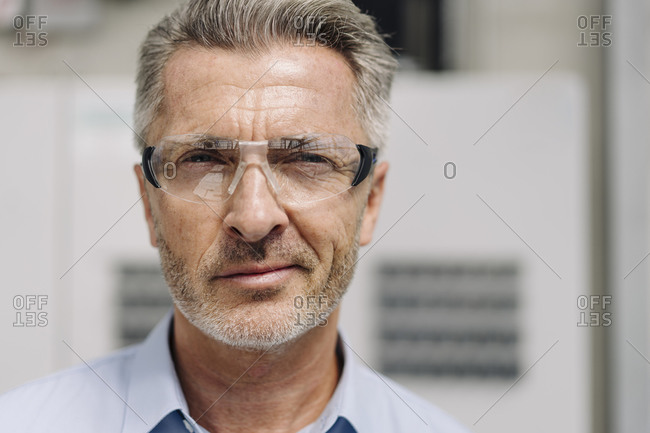 Close-up of confident male professional wearing protective eyewear