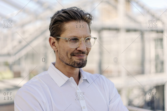 Close-up of thoughtful male professional wearing eyeglasses in plant nursery