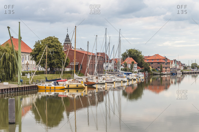 Germany- Schleswig-Holstein- Gluckstadt- Sailboats moored in harbor of riverside town