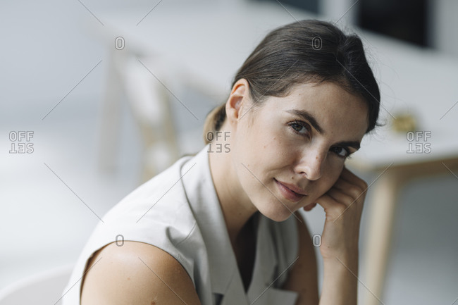 Beautiful woman sitting on chair at office