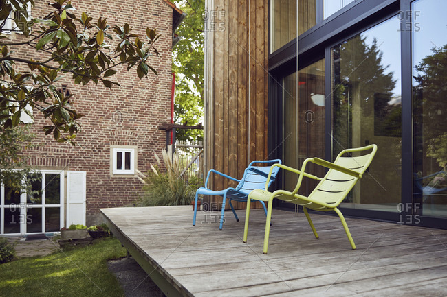Empty chairs on hardwood floor outside tiny house