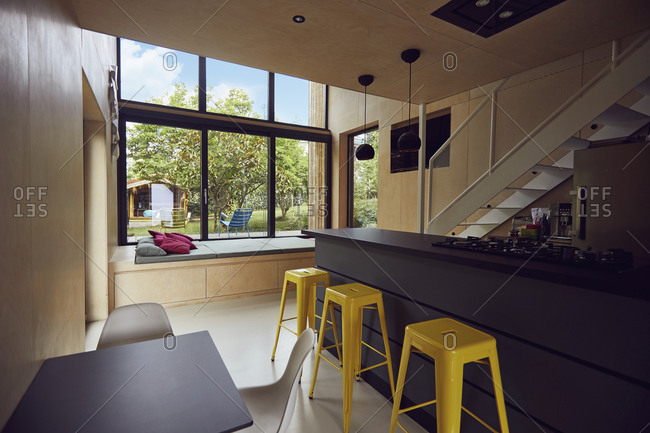 Empty yellow stools by kitchen counter in tiny house