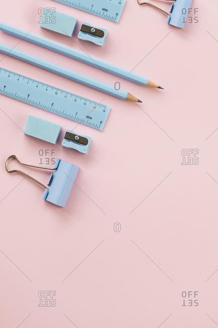 Studio shot of pastel blue school supplies