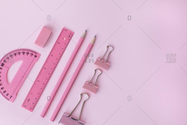 Studio shot of pink school supplies
