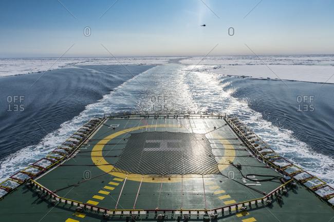 Helipad of ice-breaker 50 Years of Victory cleaving through ice of Arctic Ocean