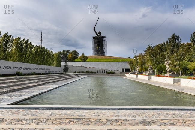 October 4, 2019: Russia- Volgograd Oblast- Volgograd- Pond and Motherland Calls sculpture at Mamayev Kurgan