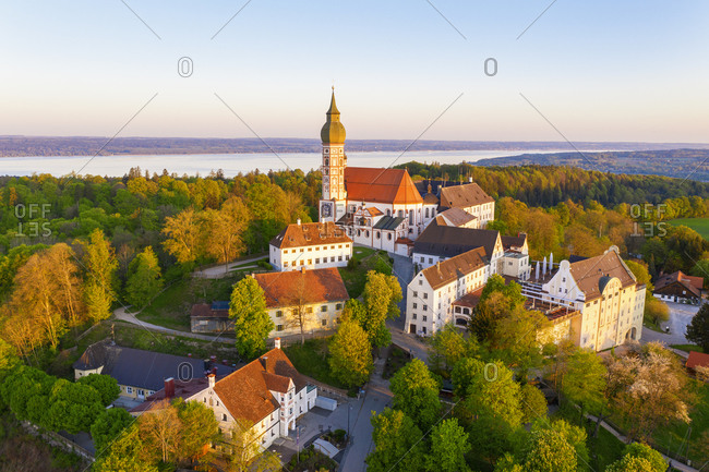 Germany- Bavaria- Andechs- Drone view of Andechs Abbey and surrounding buildings at dusk