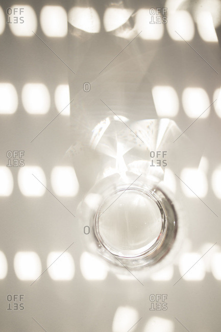 Empty glass on a white table