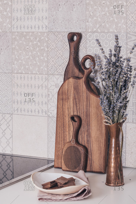 Lavender in a vase on the kitchen counter with wooden boards