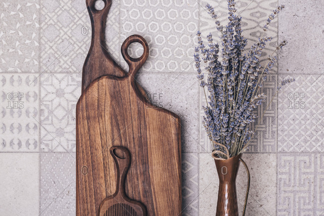 Lavender in a vase in the kitchen with wooden boards