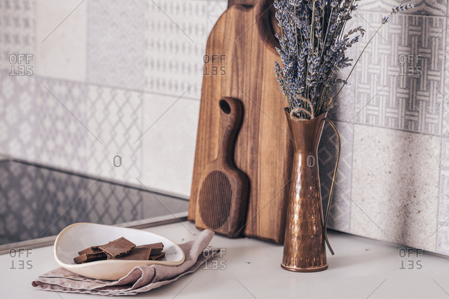 Copper vase with lavender on the kitchen counter with wooden boards