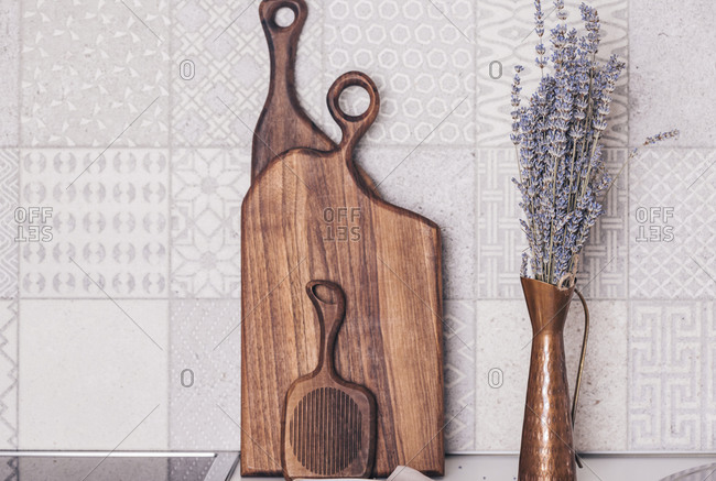 Copper vase with lavender in the kitchen with wooden boards
