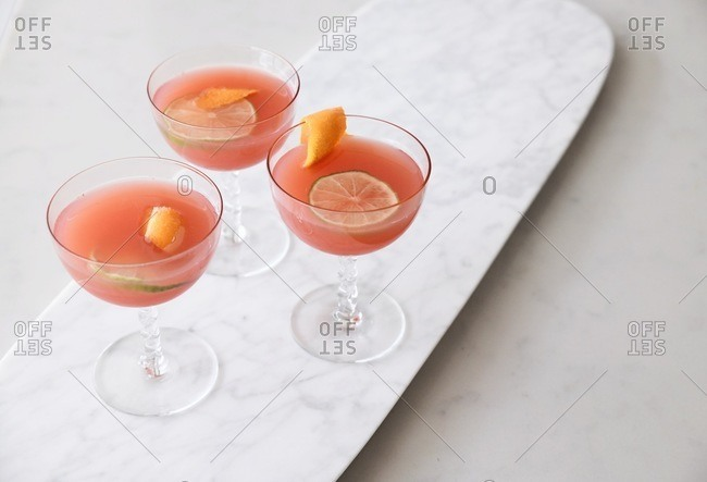 Pink fruity cocktails in coupe glasses