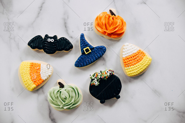Adorable Halloween sugar cookies on a marble surface