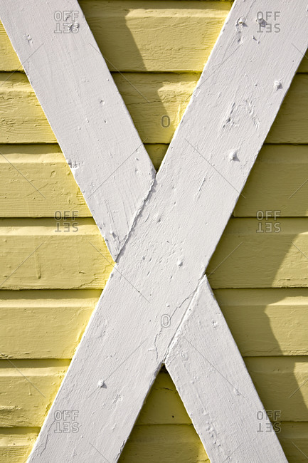 Building exterior, wood cladding, cross beams, white and yellow woodwork