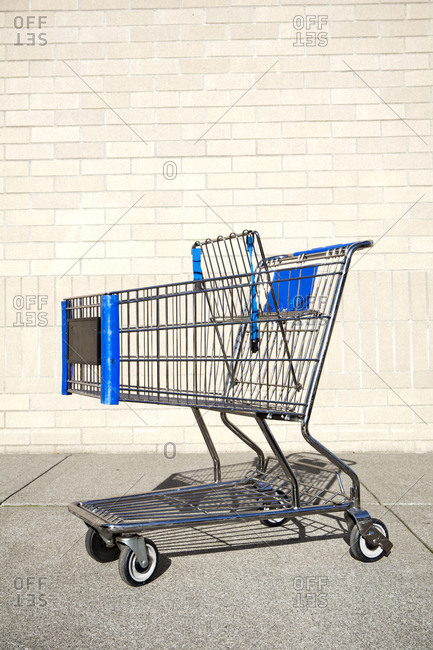 Abandoned shopping cart, trolley, metal and plastic