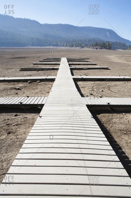 Boardwalk on a dry desert, wooden planks