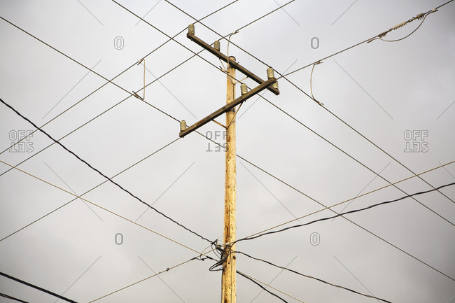 Low angle view, crossing wires overhead, telegraph pole, infrastructure