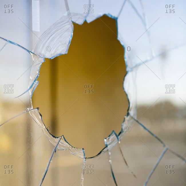 Broken glass, window pane, cracked glass pattern
