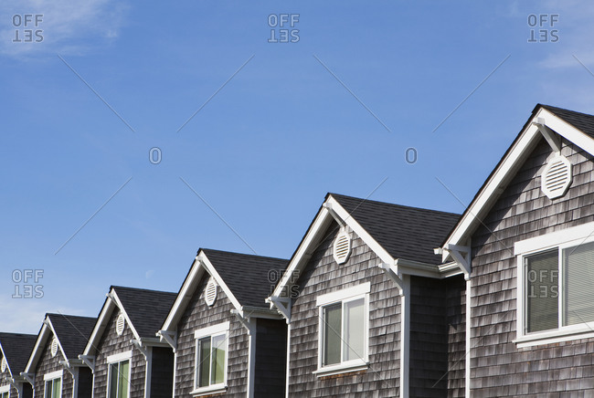 Row of houses, all the same, pitched roof and upstairs window