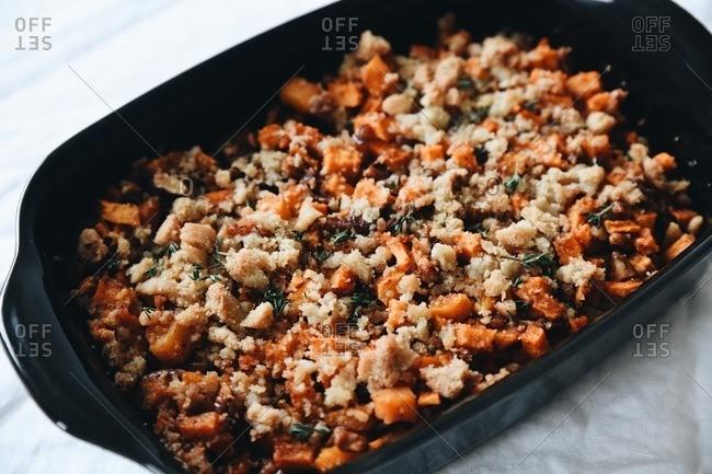Sweet potato stuffing in a black casserole dish