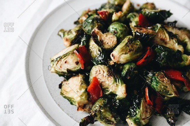 Close up of roasted brussels sprouts with red peppers