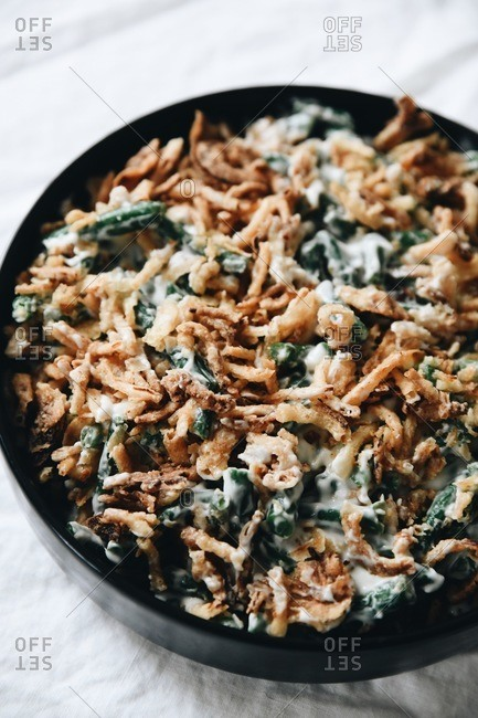 Close up of green bean casserole in a round black dish