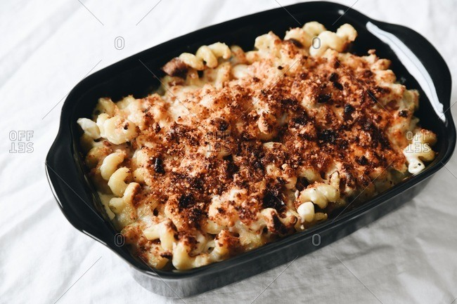 A baked macaroni and cheese dish with spiral noodles