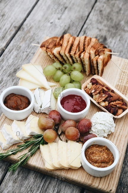 Fruit and cheese board served on rustic wooden table