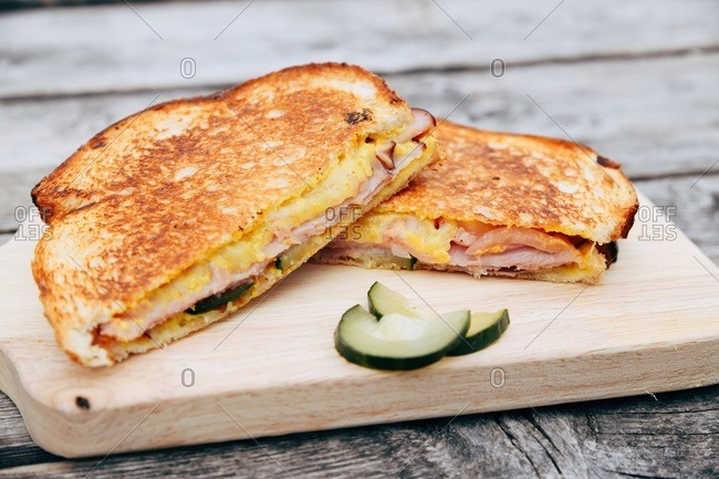Grilled ham and cheese sandwich with pickles