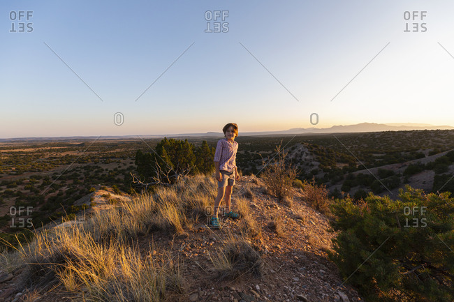 Young boy overlooking Galisteo Basin, Santa Fe