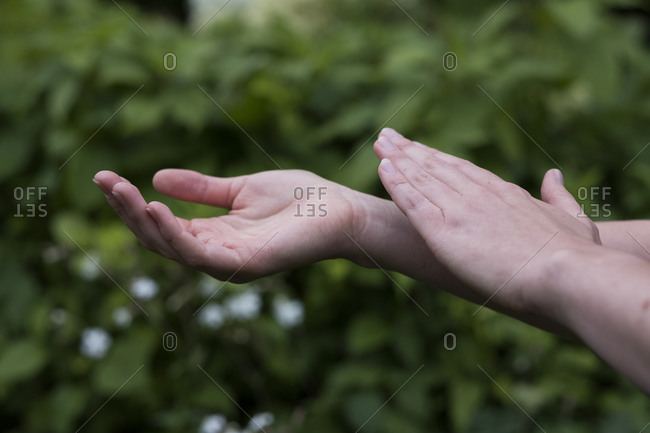 Close up of hands touching, EFT tapping therapy technique.