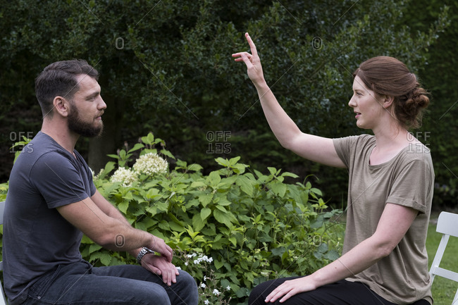 Man and female therapist in a garden, sharing techniques of EFT