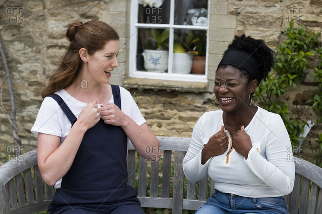 Woman and female therapist talking in a garden.