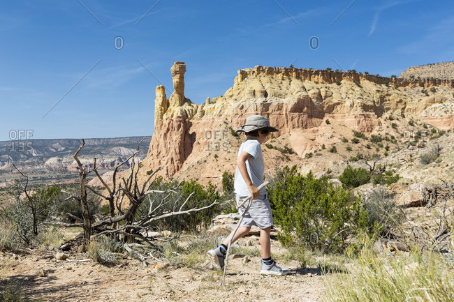 young boy looking at Chimney Rock, through a protected canyon landscape