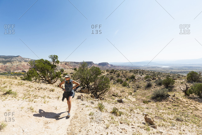 adult woman hiking at through a protected canyon landscape