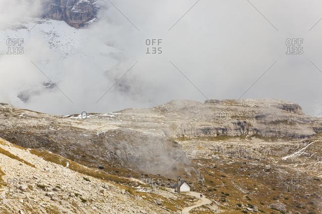 Landscape with small remote church in Trentino-Alto Adige, Dolomiti di Sesto Natural Park, Bolzano, South Tyrol, Italy.